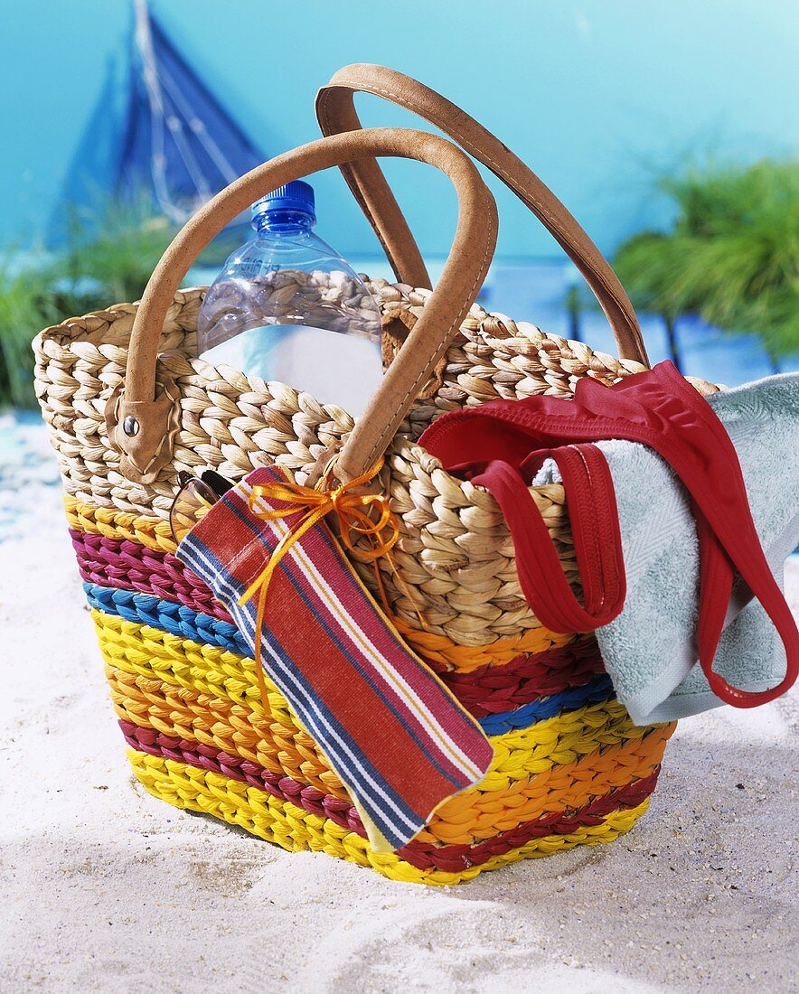 Beach bag with bottle of water, swimsuit & mobile phone bag
