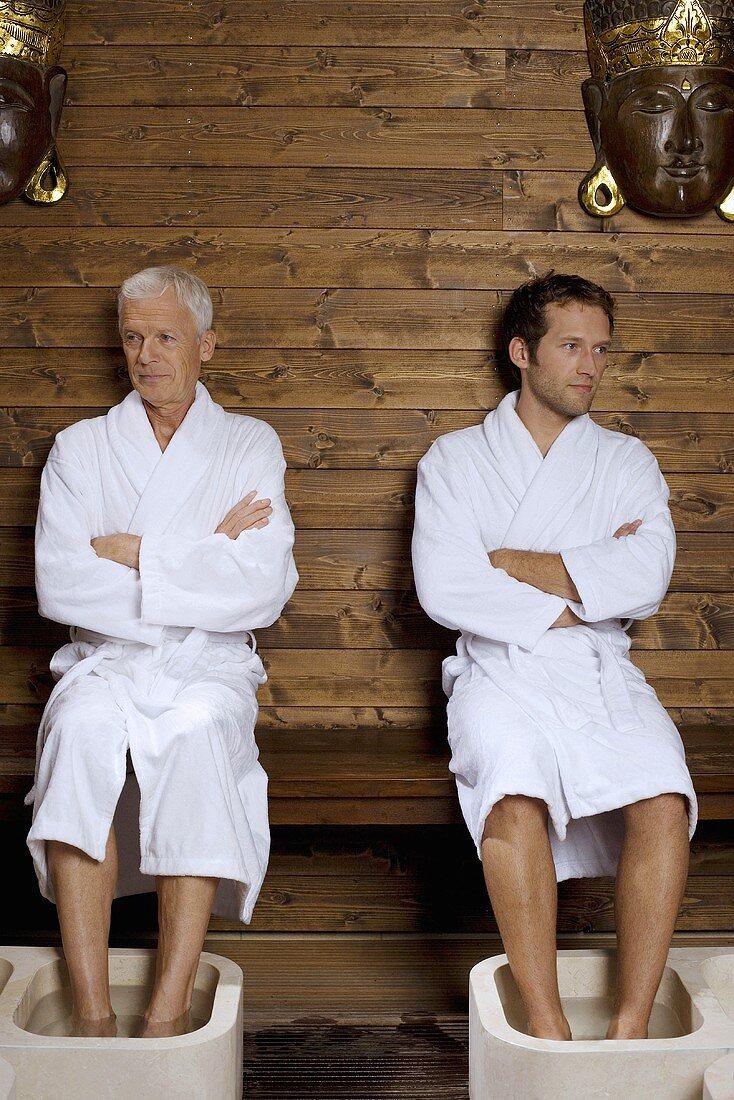Germany, two men having foot bath
