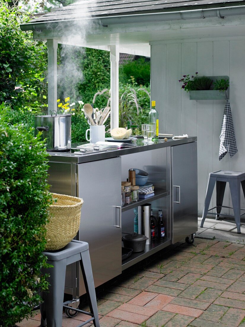 Mobile, stainless steel outdoor kitchen with ceramic hob, sink & fridge