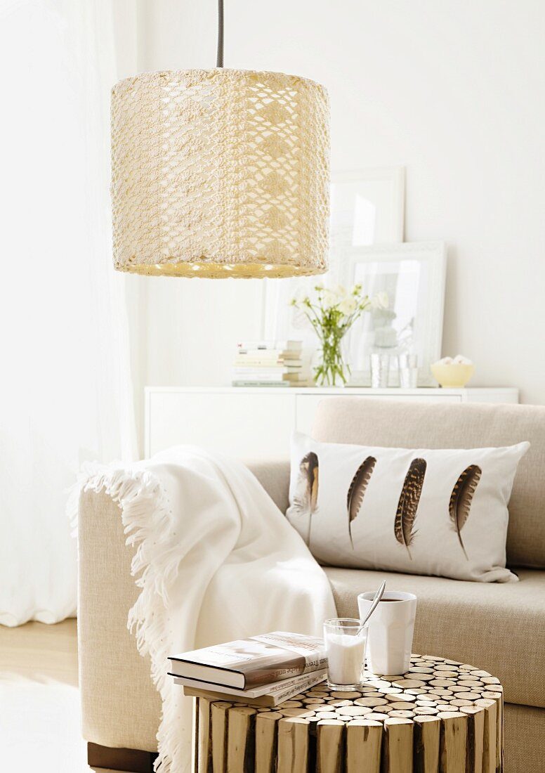 A lamp with a crocheted lampshade