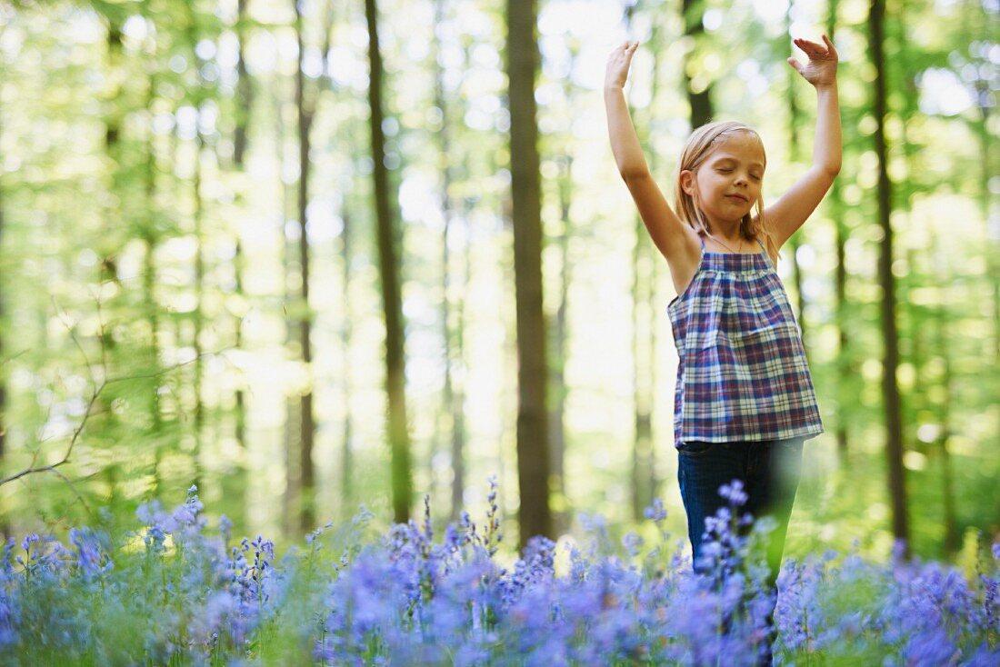 Girl dancing in field of flowers
