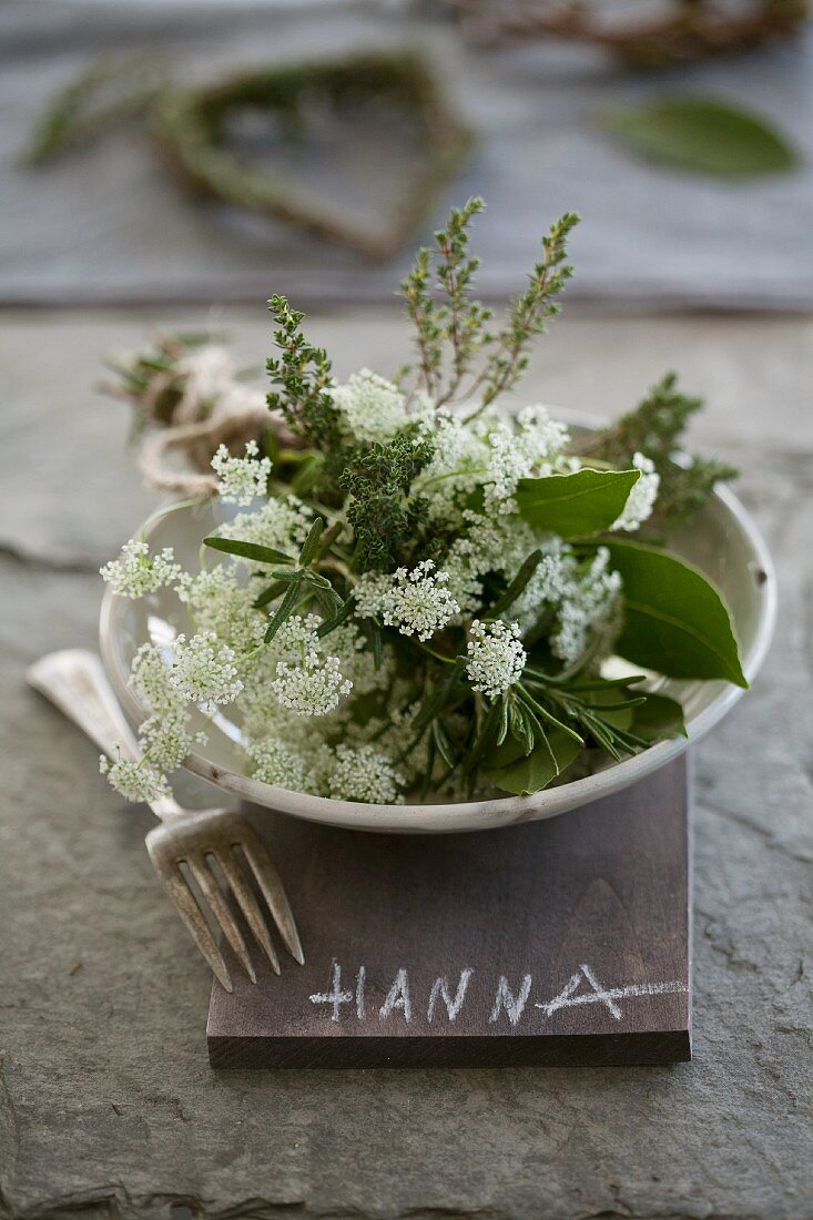 Rosemary, thyme, cow parsley and bay leaves in a dish