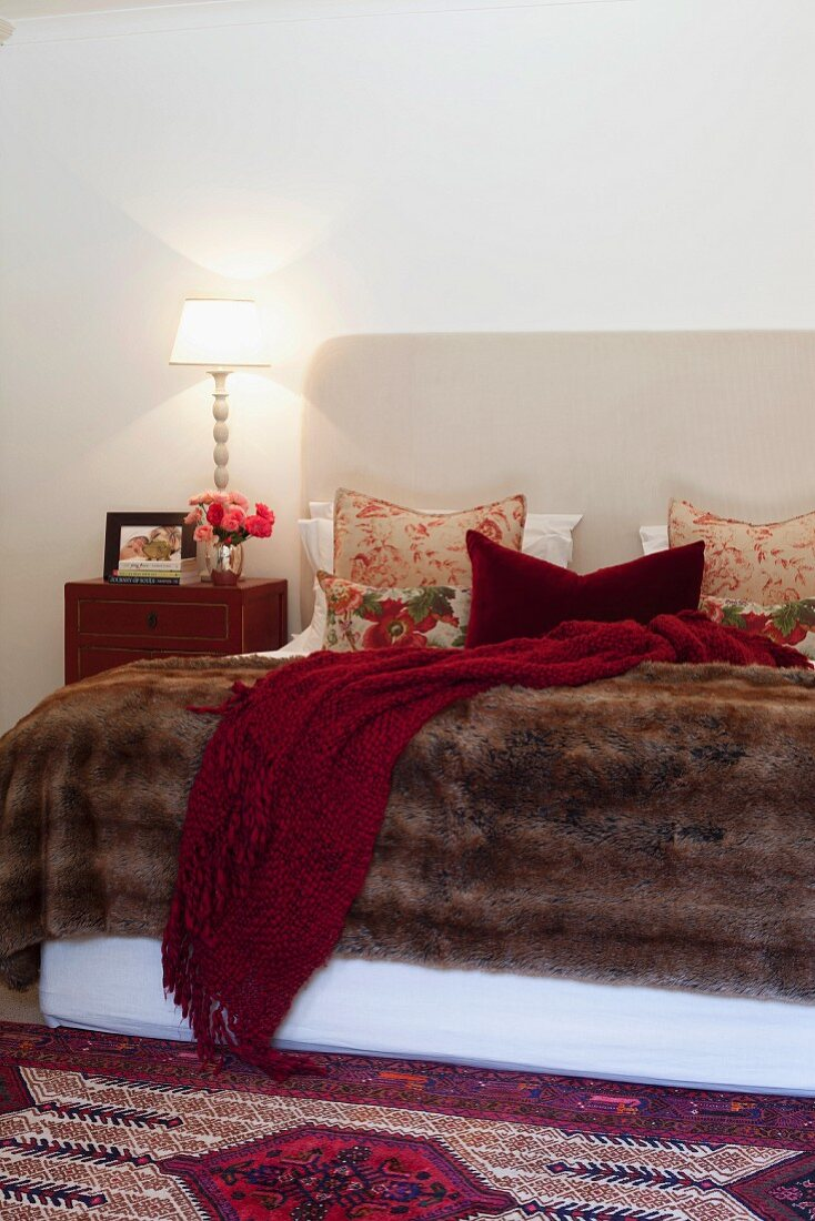 Double bed with a animal skin cover