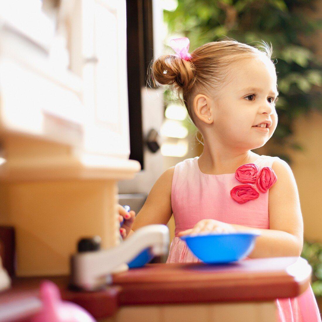 USA, Arizona, Chandler, Girl (2-3) wearing pink dress playing outdoors