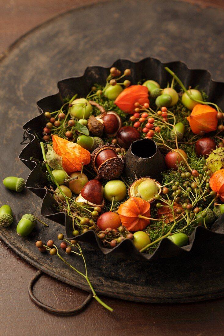 Autumnal arrangement in old baking tin
