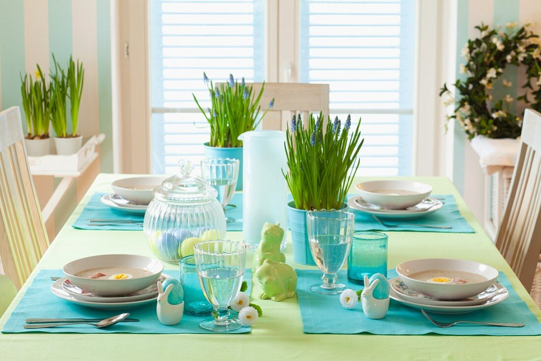 Festively set Easter table with potted grape hyacinths