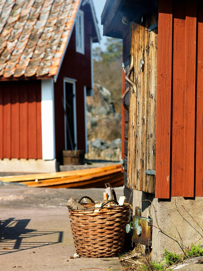 Firewood in front of a smokehouse, Sweden.