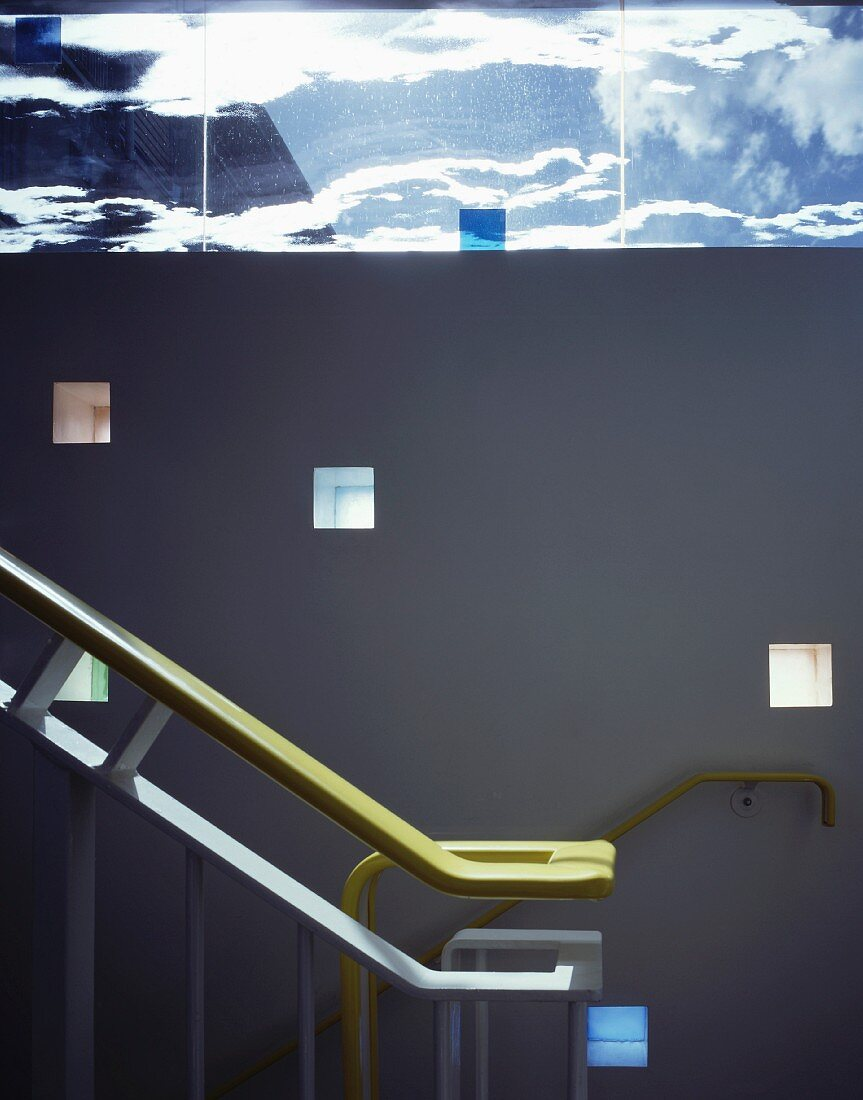 Stairwell with handrail and niches