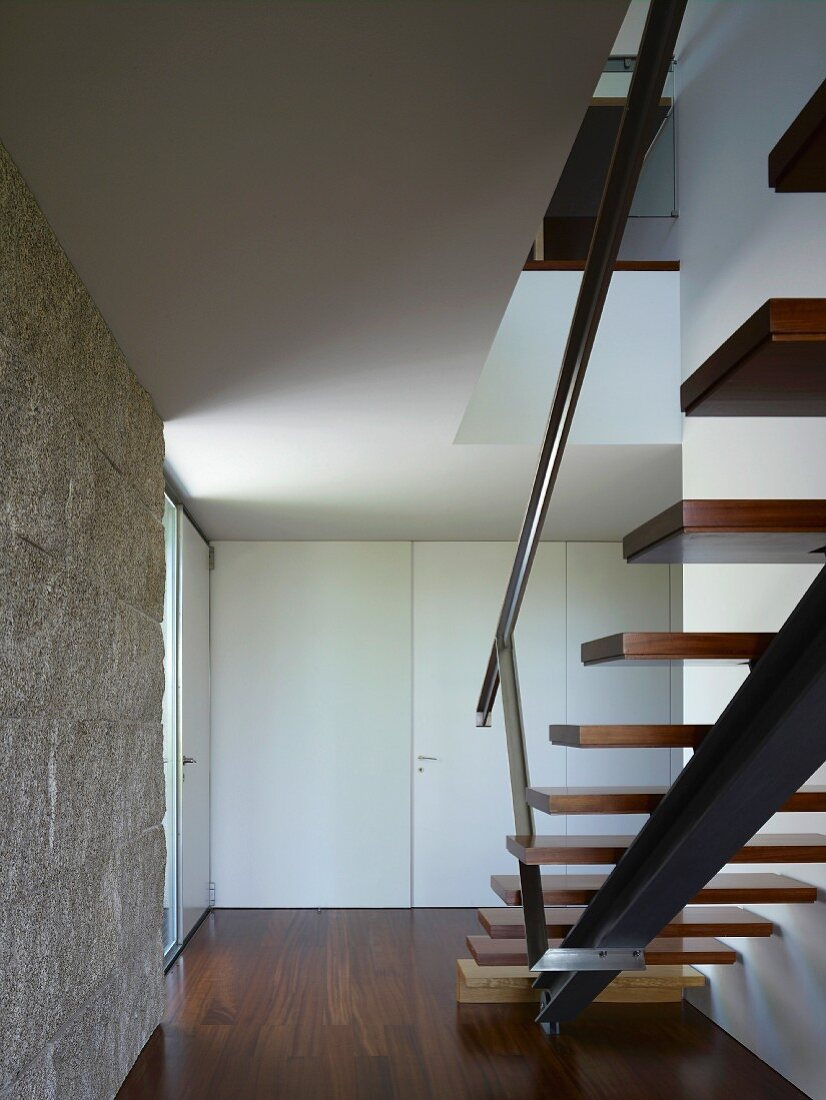 Stairwell with wooden staircase
