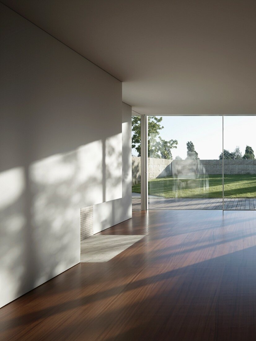 Empty living space with wooden floor and terrace windows