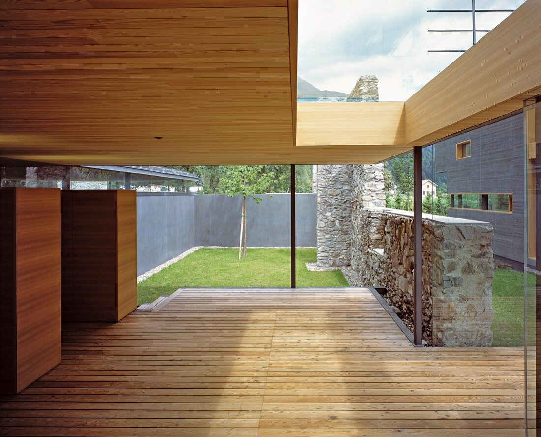 Roofed terrace with stone wall