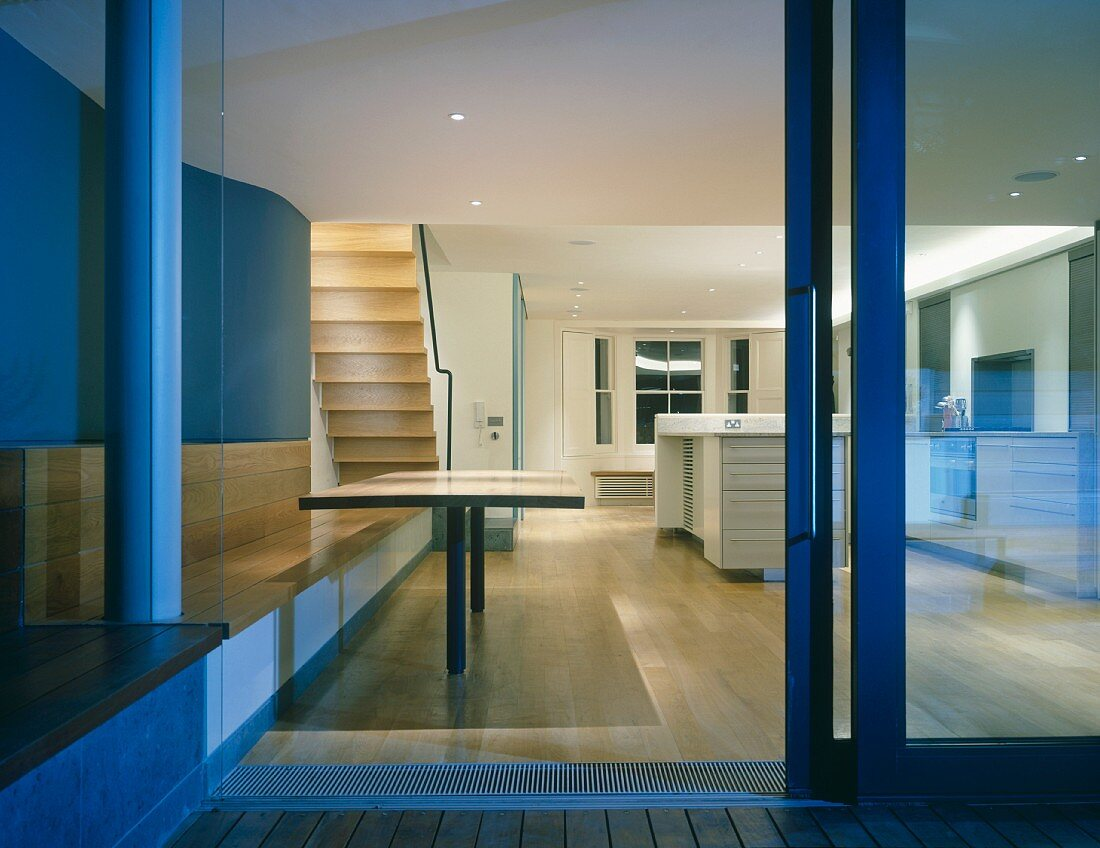 View from terrace into open-plan living space