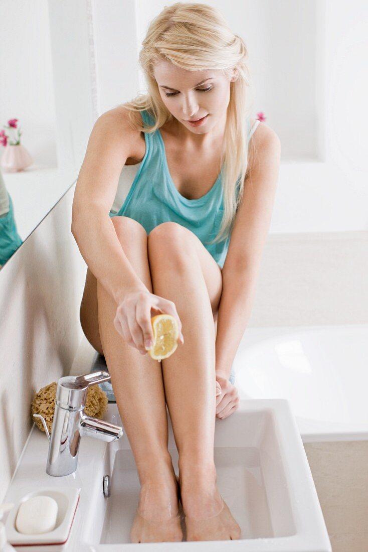 Blonde woman enjoying a lemon footbath