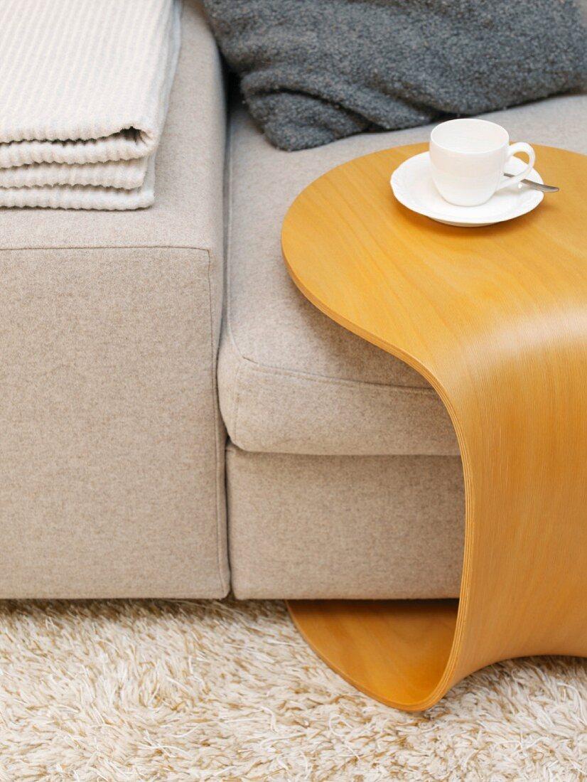 Side table with teacup and saucer over sofa