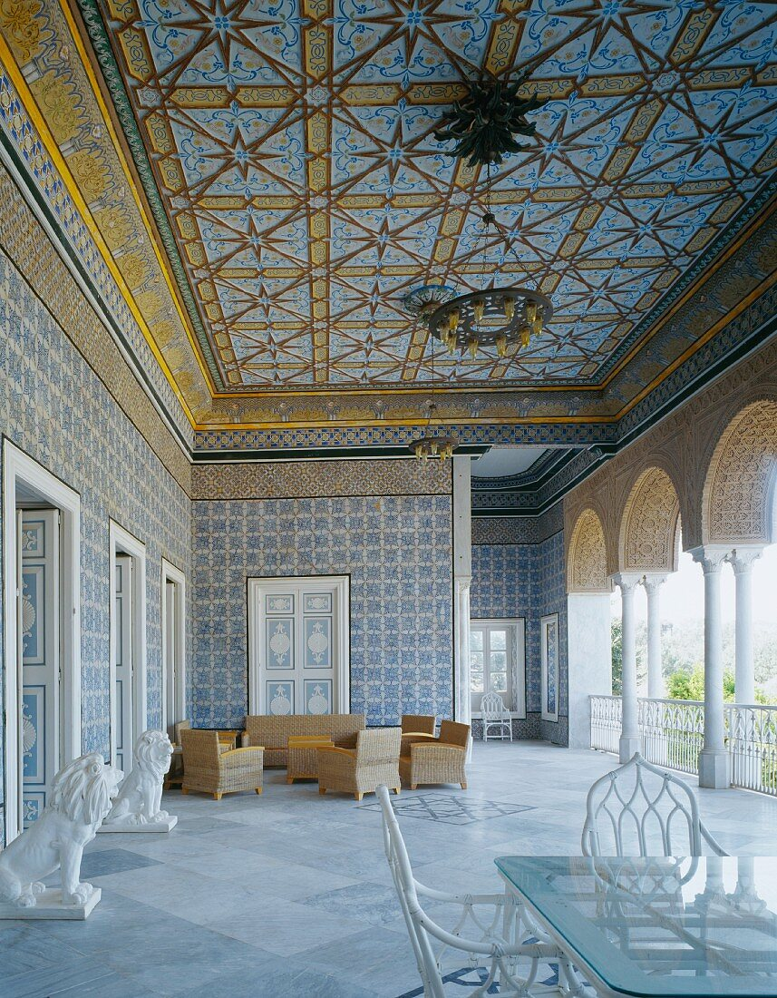 Sumptuous open-sided entrance loggia in North African style with seating and lion figures