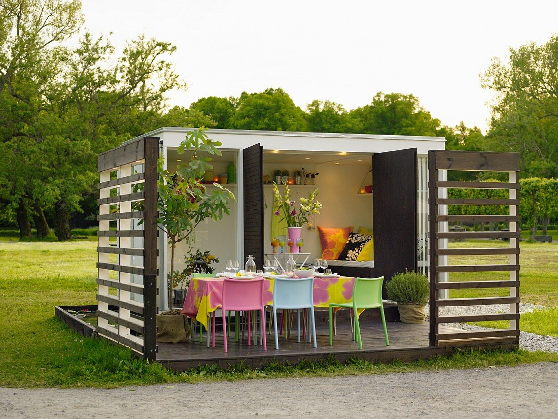 Modern garden pavilion with a set table on a terrace