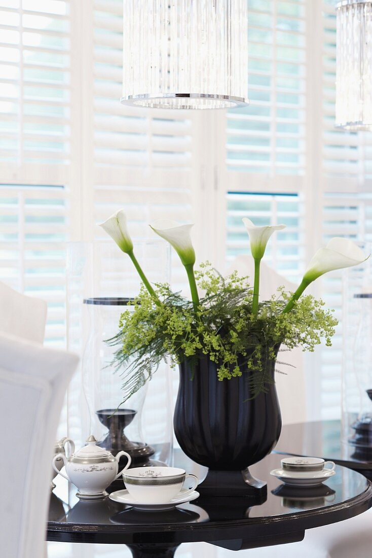 Floral arrangement with calla lilies on a living room table