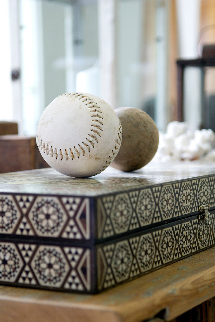 Stitched leather ball and sphere on marquetry board-game case