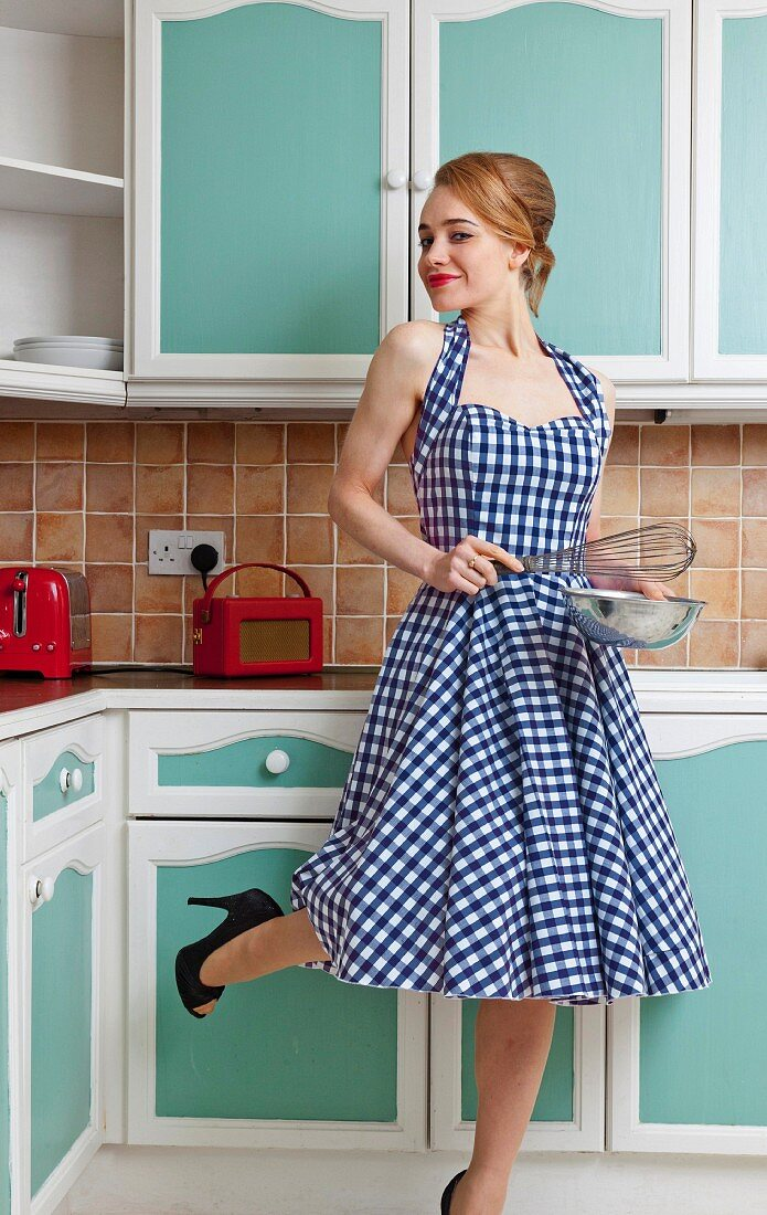 Smiling woman cooking in kitchen