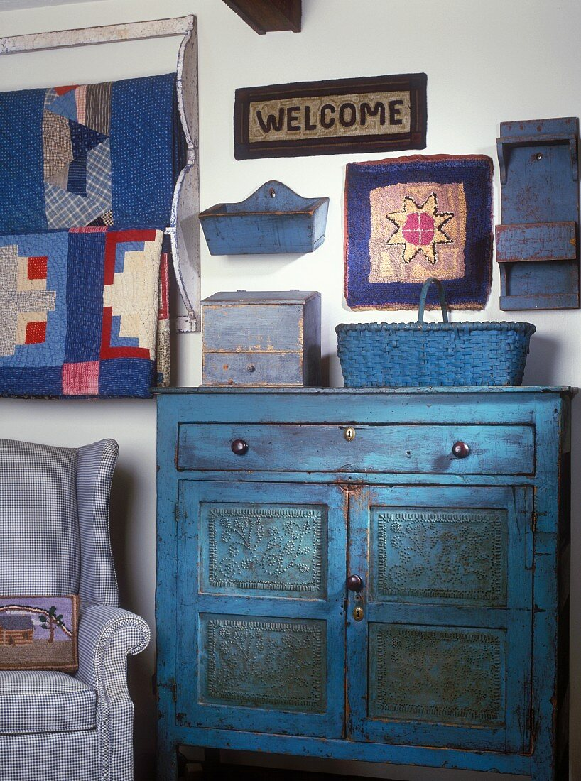 Vintage cabinet, armchair and ornamental items in various shades of blue