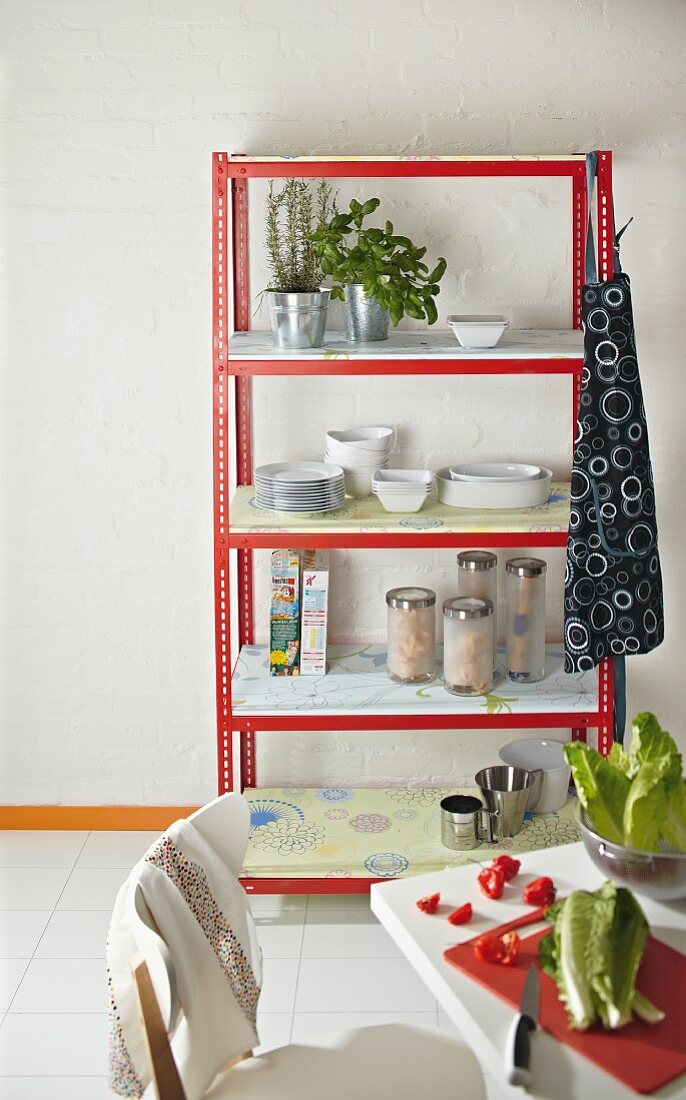 DIY kitchen shelves made from metal rails and wallpapered chipboard shelves