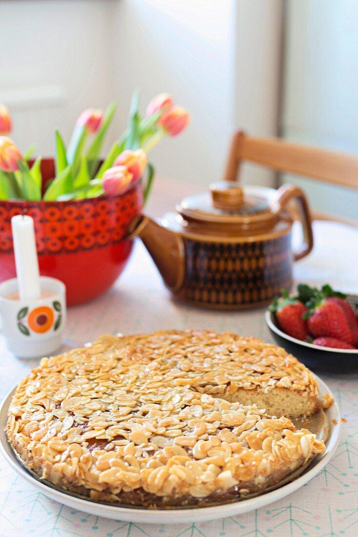 Swedish tosca cake and retro crockery on table