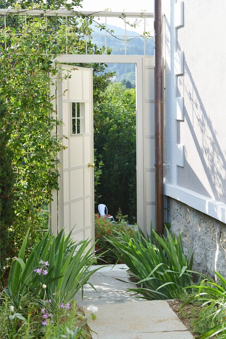 Stone-flagged garden path and view of hills
