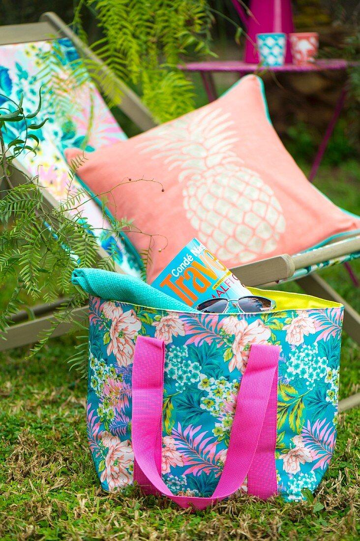 Deckchair, cushions and beach bag in summer seating area