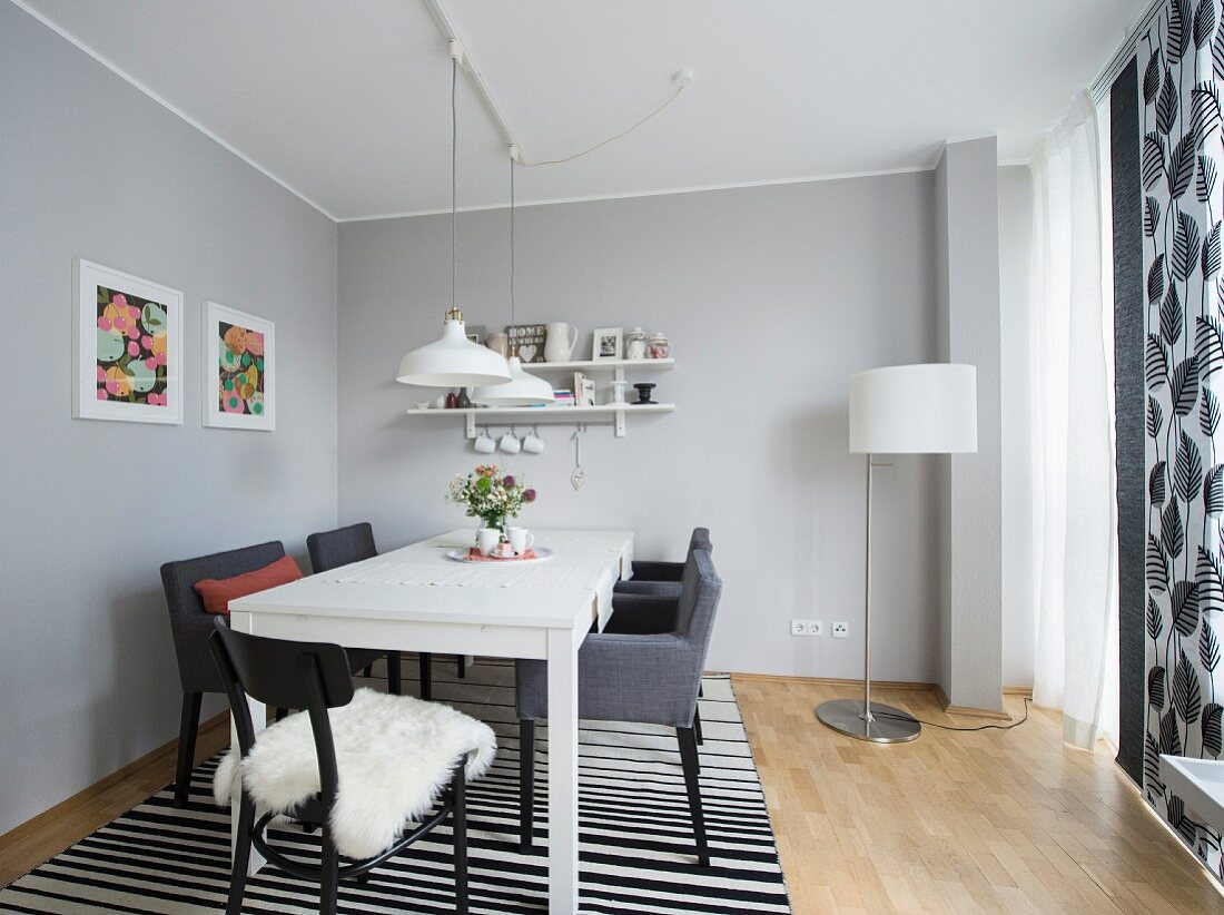 A modern dining room in black, grey and white