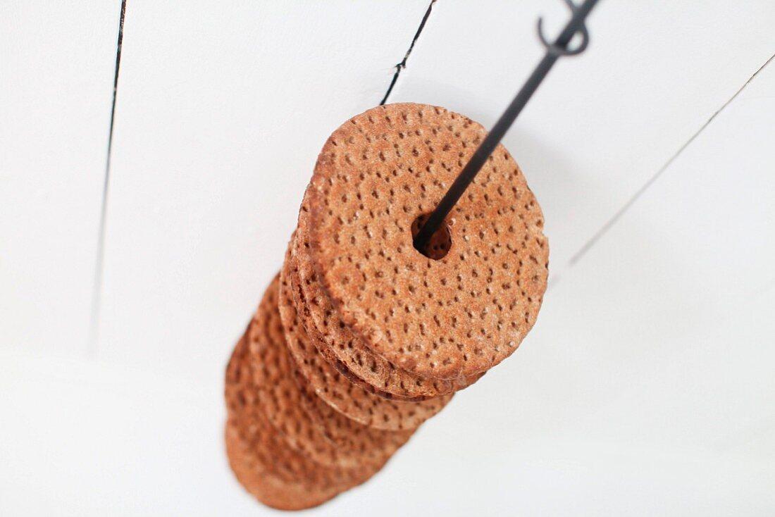Swedish crispbread threaded on suspended metal rod