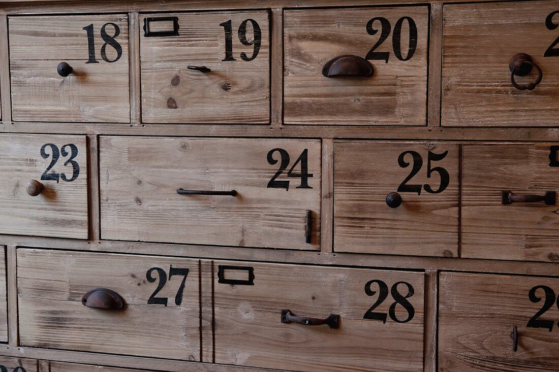 Full frame shot of numbers on wooden drawers; Azusa; California; USA