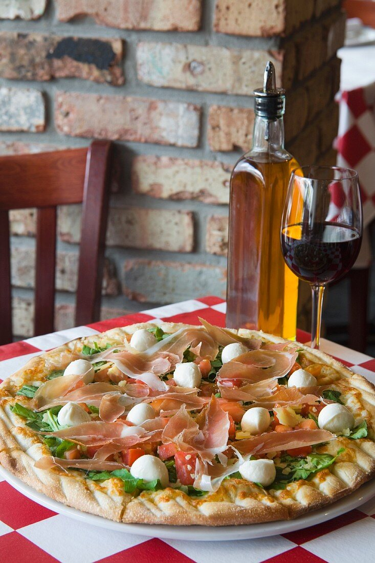 Pizza with delicious toppings on table at Archie's Pizza