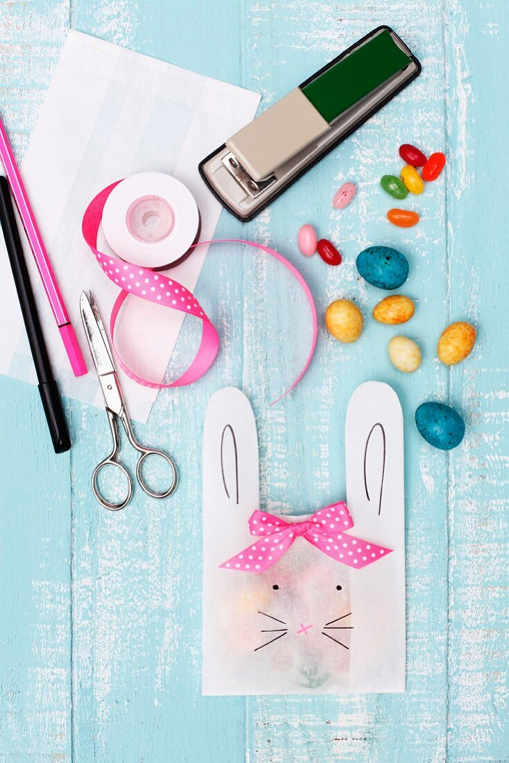 Easter decorations - paper bag with cut-out bunny ears, drawn-on face and ribbon bow