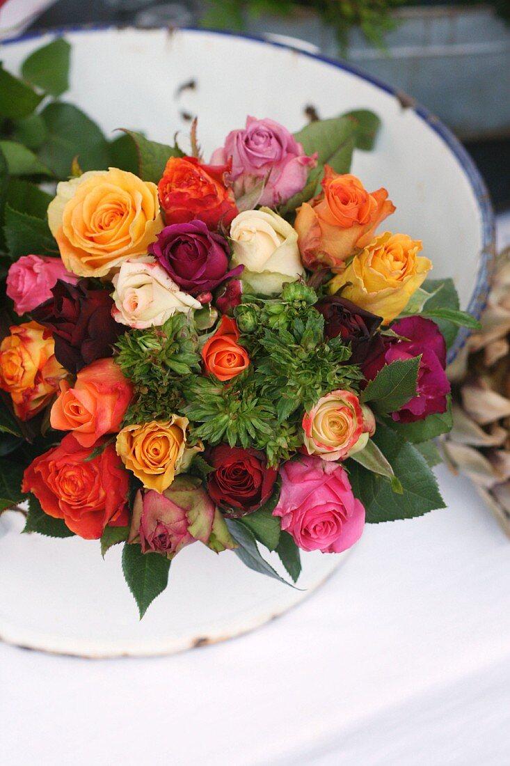 Enamel bowl of spray roses