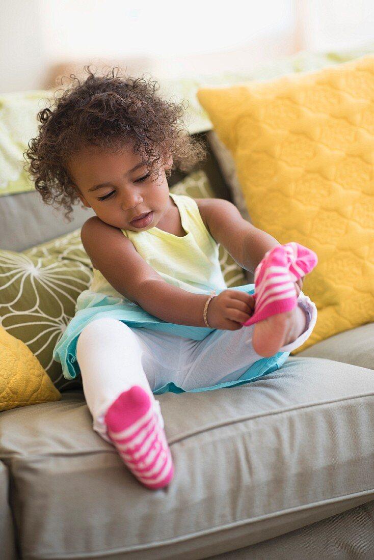 Little girl wearing pink socks