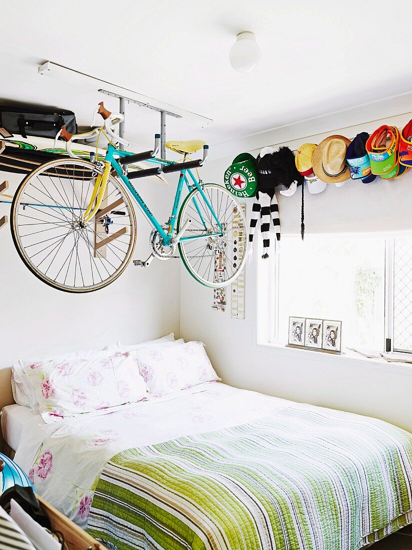 Racing Bicycle Hung From Shelf Above Bed Buy Image 11349749 Living4media