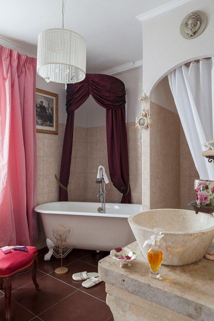 Vintage bathtub in renovated bathroom with antique, elegant ambiance