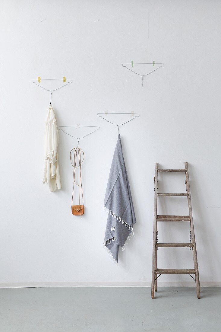 Improvised coat rack made from wire coat hangers