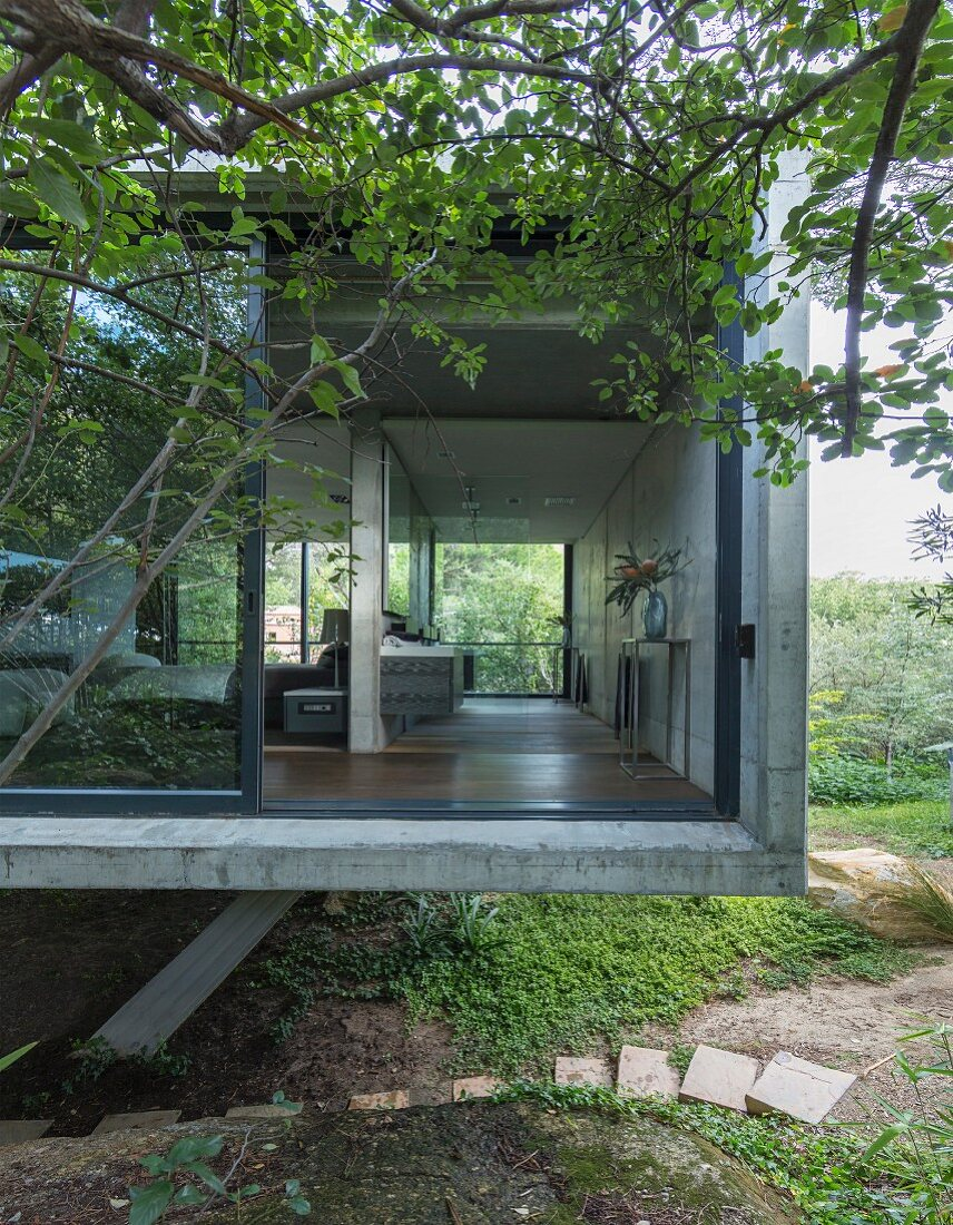 Cubic, concrete house with sliding glass walls