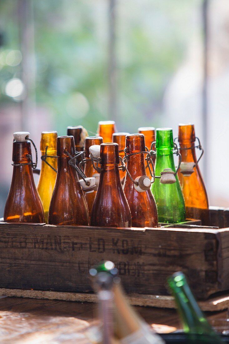 Old beer bottles in rustic wooden crate