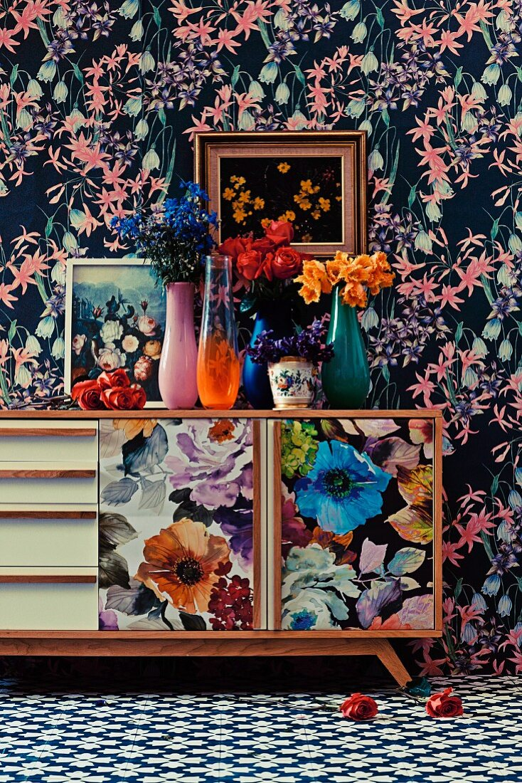 Floral pattern mix on wallpaper, sideboard, paintings and carpet