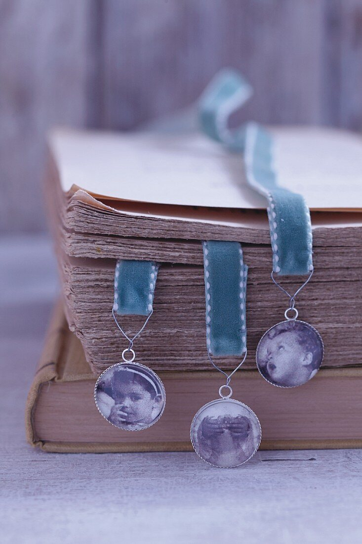 Homemade bookmarks with family photos on velvet ribbons