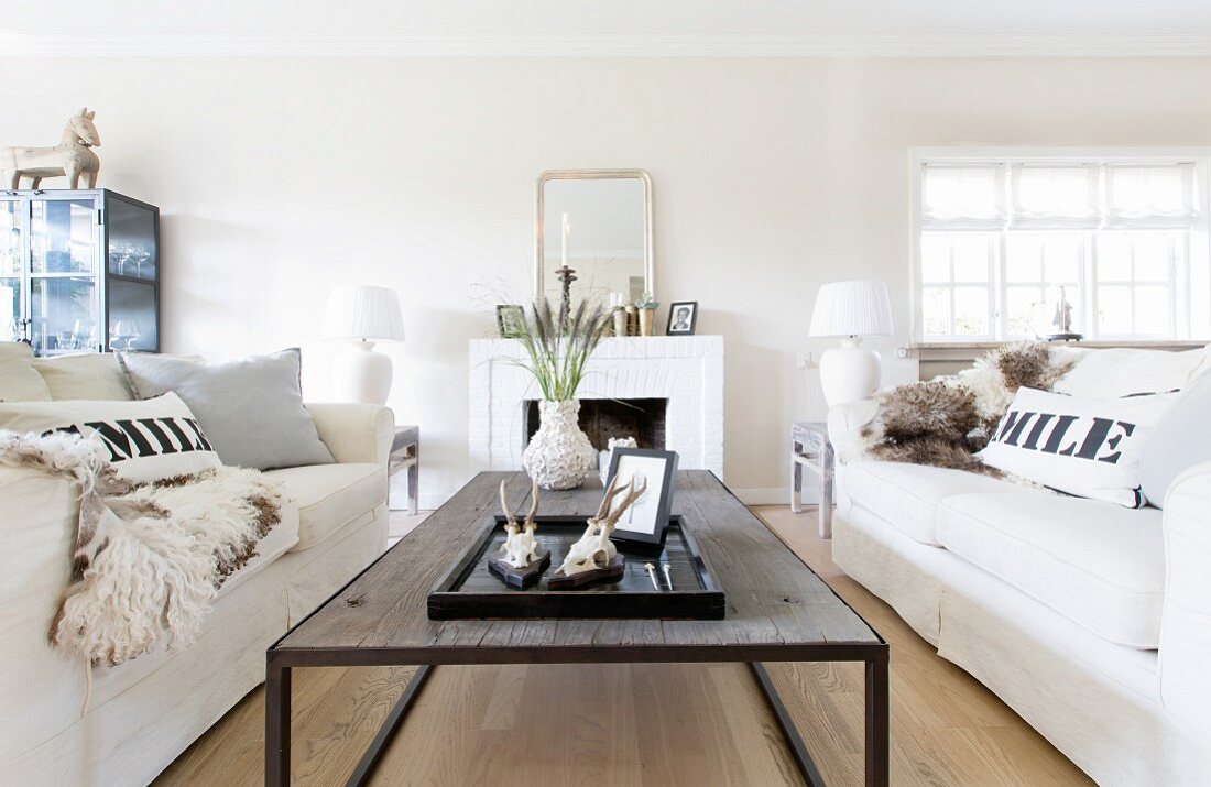 Two sofas facing one another in front of open fireplace