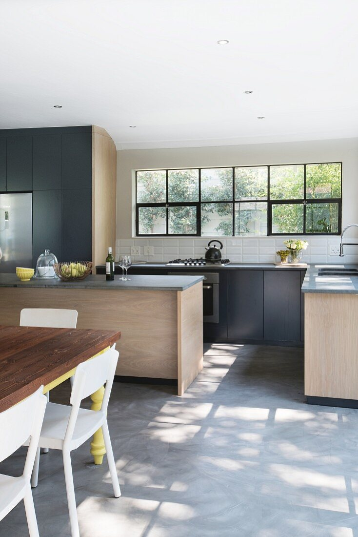 Dining area in modern kitchen with light … – Buy image – 9 ...