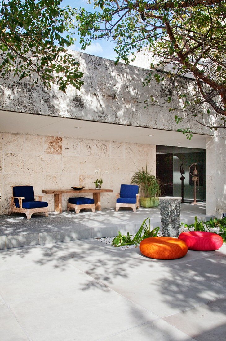 Colourful seating on terrace of modern house