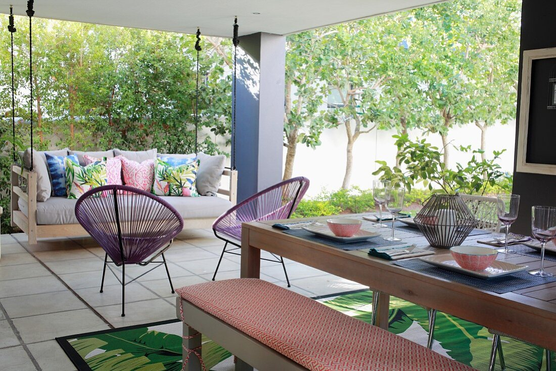Swing couch and set table on roofed terrace