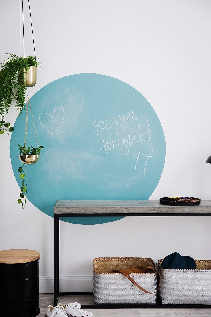 Blue circle with blackboard paint above the console table in the hallway