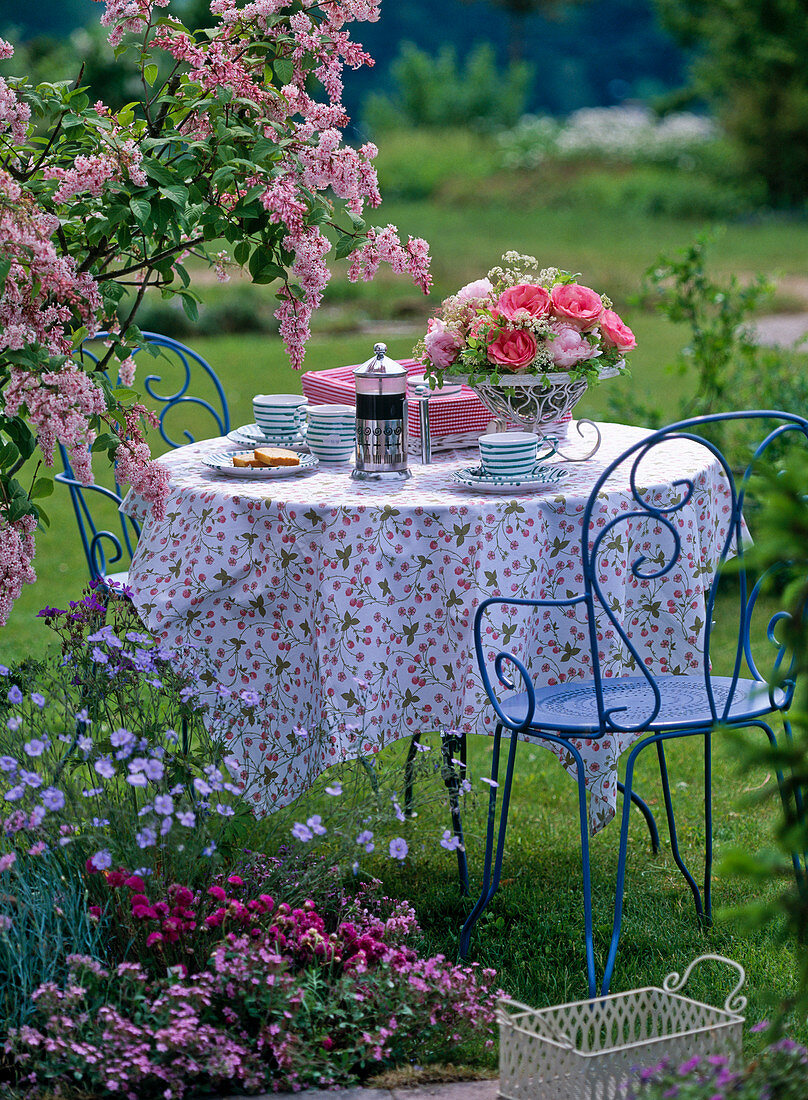 Table with arrangement of pink (rose), Paeonia (peony)