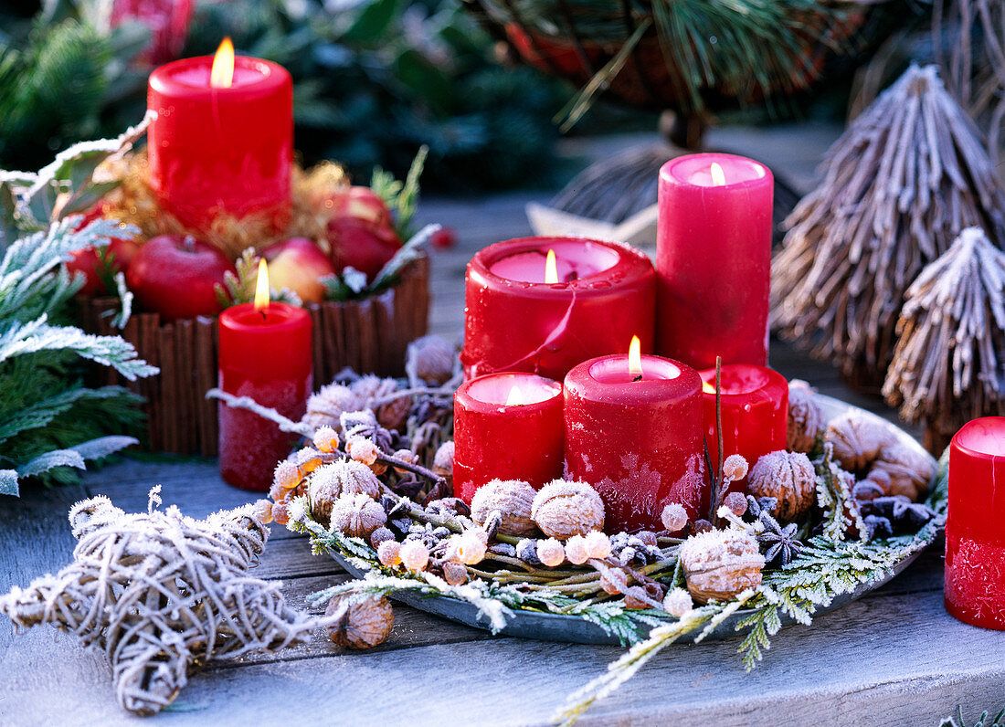 Metal tray with red candles, Juglans, Salix, Chamaecypa