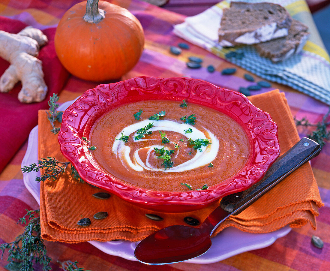 Pumpkin soup in red plate